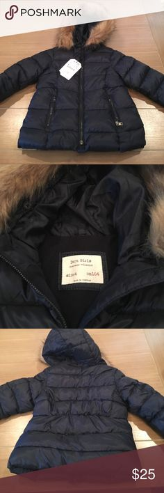 Navy Blue Zara Kids Puffer Coat Sz 4 Navy blue Puffer Coat Sz 4 with removable fur around hood. Is lined with fleece. Has two pockets at front. New with tag and never worn. Zara Jackets & Coats Puffers
