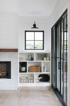 Modern Farmhouse House Tour - Modern Farmhouse House Tour Fireplace built-ins The fireplace is flanked by asymmetrical built-ins with windows and shiplap above Built In Shelves Living Room, Living Room Windows, Living Room With Fireplace, My Living Room, Small Living, Modern Living, Living Spaces, Fireplace Windows, Fireplace Shelves