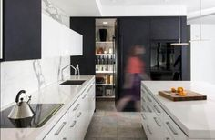 a clever monochromatic kitchen and eating area | @meccinteriors | design bites | #kitchen #hiddenpantry