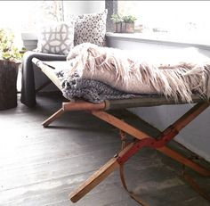 Vintage army  cot I found on Craigslist ...now at home on my front porch