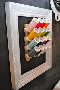 love this idea to dress up utilitarian spool holder.
