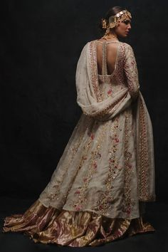 Ivory and gold bridal peshwas with zardozi work and colored florals paired with an ivory cutwork zardozi and resham dupatta paired with a crushed chatta patti farshi lehnga Pakistani Couture, Pakistani Bridal Dresses, Indian Couture, Desi Wedding Dresses, Indian Wedding Outfits, Indian Outfits, Embroidery Suits Design, Embroidery Dress, Indian Embroidery