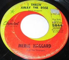 1967 45 Rpm Merle Haggard I THREW AWAY THE ROSE / LONELINESS IS EATING ME ALIVE On Capitol 5844.. As a performer and a songwriter, Merle Haggard was the most important country artist to emerge in the 1960s, and he became one of the leading figures of the Bakersfield country scene in the '60s. While his music remained hardcore country, he pushed the boundaries of the music quite far. Like his idol, Bob Wills, his music was a melting pot that drew from all forms of traditional American music..