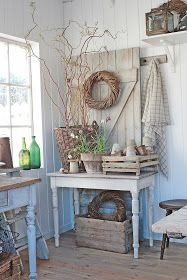 AWESOME neutral potting shed area - old clay pots branches grain sacks trays stool old worn farmhouse tables old glass bottles lantern wicker wood floor - heavenly ? Farmhouse Table Centerpieces, Farmhouse Decor, Country Farmhouse, Country Homes, Country Life, Old Glass Bottles, Deco Champetre, Vibeke Design, Rustic Kitchen Design