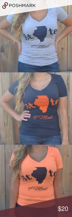 """State of Mind Graphic Tee - IL Express yourself in Reyine's original design! Our State of Mind Tee features a super soft material, V-neck, and graphic to show off which state you identify your state of mind with.  Size & Fit:  Karyn is 5'4"""", 36D, and is shown wearing a medium.  Fit:  Runs small, tight fit, recommended to size up  Material:   Grey - 90% Cotton, 10% Polyester  Orange - 60% Cotton, 40% Polyester  Navy - 100% Cotton  Length:  Regular Bust:  Fitted  *Please let us know which…"""