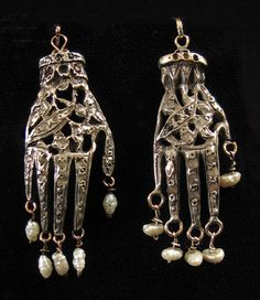 """Unusual silver khamsa or Hand of Fatima  9K gold on reverse, freshwater pearls, rough-cut diamond chips, and tiny garnets  Worn by the upper Beldi class of Tunis  2"""" high, including pearls  Early to mid-20th centur"""