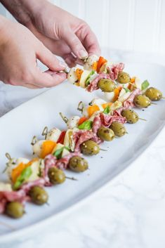 Antipasto Skewers & Party appetizers, entertaining ideas, party ideas, party recipes and more from Cyd Converse & The Sweetest Occasion Quick And Easy Appetizers, Finger Food Appetizers, Easy Appetizer Recipes, Holiday Appetizers, Yummy Appetizers, Appetizer Skewers, Antipasto Recipes, Finger Food Recipes, Brunch Finger Foods