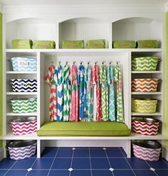 Beach gear stays organized with labeled baskets and monogrammed beach. More photos from this Michigan lake house: http://www.midwestliving.com/homes/featured-homes/house-tour-so-happy-together/?page=6