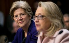 """Senator Elizabeth Warren, a Democrat from Massachusetts, left, looks on as U.S. Secretary of State Hillary Clinton speaks during a Senate Foreign Relations Committee nomination hearing in Washington, D.C., U.S., on Thursday, Jan. 24, 2013. Senator John Kerry stressed the need to prevent Iran from acquiring nuclear weapons. He described the """"immediate, dangerous challenges"""" facing the nation as he seeks confirmation to become secretary of state. Photographer: Andrew Harrer/Bloomberg via…"""