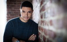 """A REFLECTIVE MOOD: Trevor Noah was photographed in his office backstage at """"The Daily Show."""" He's wearing a wool knit sweater by Ermenegildo Zegna, $695."""