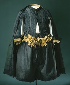 The quilting, doublet trim and ribbons.  1658 suit in black silk (rips). The trousers are decorated with yellow silk ribbons tied into bows. Worn by Karl X. Gustav of Sweden