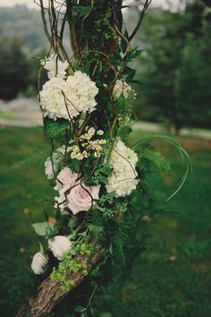 simple flowers added to arbor