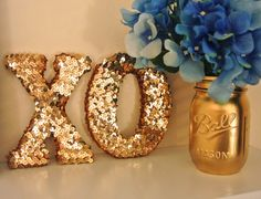 "Glue gold sequins to cardboard letters to create quick and chic sorority decor. This makes a great (and inexpensive) gift for any big or little! IT""S AN XO! Sorority Decorations, Sorority Crafts, Cardboard Letters, Diy Letters, Gold Letters, Painted Sorority Letters, Glitter Letters, Diy And Crafts, Arts And Crafts"