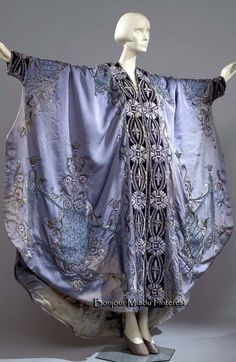 Dressing gown, Italian (?), ca. 1900–10. Sky blue padded silk trimmed with midnight blue velvet and embroidered with silk and chenille. Lined in light blue silk satin. Costume Gallery of the Pitti Palace via Europeana Fashion