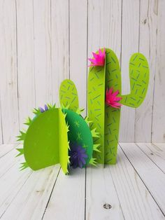 This centerpiece is fun and festive without obstructing table conversation. This centerpiece includes 2 self standing cacti with 3D flowers. Tall cactus measures aporximately 12 inches tall both of them together measure aporximately 12 inches wide. There are multiple shades of green on these cacti.