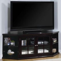Fullerton Transitional Corner Media Unit with Doorsby Coaster - This elegant media console will be a stylish addition to your living room, offering clean lines and ample storage space. The transitional style TV stand has a rich espresso finish, with a generous top surface for your television. The corner style of this piece allows you to make the most of your space, fitting right into the corner of your living room.