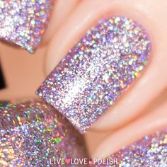 KBShimmer Things That Make You Go Bloom is a lilac tinted base filled with silver holographic glitter.