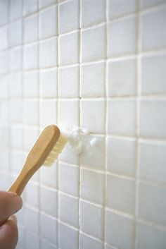 """It can cost an arm and a leg to buy the """"right"""" cleaning stuff for all that tile you have around the house. Instead, round up hydrogen peroxide, baking soda, and a tooth brush—then start brushing. There will be zero dirt and grime once you're done...pinky promise!  Get the full how-to instructions at The How To Crew.    - Redbook.com"""
