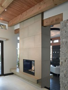 thinking of opening our fireplace from the living room to the den like this.