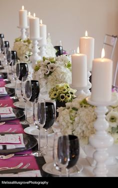 black, white and pink table arrangement - wedding reception centerpieces  I like the idea of classic black and white. But I would prefer a different accent color