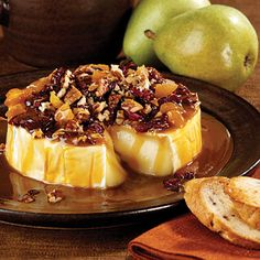 Jo Ann's Holiday Brie is drizzled with caramel and sprinkled with nuts. It might be the easiest (and most beautiful) dish on your table...