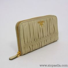 Prada Cream Gaufre' Nappa Leather Wallet  Siopaella Designer Exchange Dublin you can purchas this on line at http://siopaella.com/ or call is on 01-6771906
