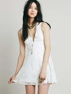 Reign Over Me Sleeveless Dress | Sleeveless version of FP fave Reign Over Me Dress, this deep V mini dress has a sheer mesh overlay with beautiful embroidery and scalloped trim. Hidden side zip. Lined.