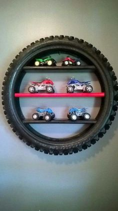 For Car mad children. Use an old tyre as a shelf in a playroom/bedroom