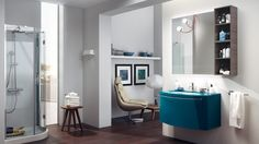 """Aquo 12345678910111213info For small spaces: glossy lacquered monobloc (Baltic Blue) with polished glass top in the same colour, """"Detail"""" washbasin, open-shelf elements (in Melamine Grey Teak finish). The """"Link"""" mirror is complemented by two """"Magnetique"""" lamps."""