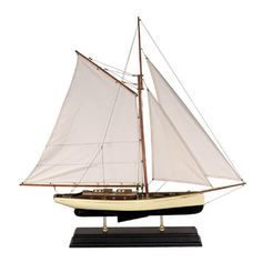 Features:  -Supported by two brass feet.  -Bronze portholes.  -Molded antique finish stand.  Product Type: -Model boat/Car/Plane.  Style: -Asian Inspired.  Theme: -Historic.  Subject: -Boats and ships
