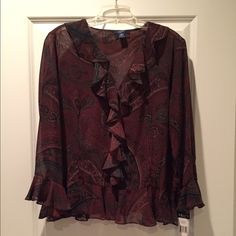 New sheer cover blouse 3/4 sleeve blouse with a paisley print in browns, tans, & green.  Sheer so you'll want a tank to wear under (not included).  Ruffle at the bottom and end of sleeve as well as down the front.  Very easy to dress up or down.  Never worn, new with original tags.                                            100% polyester.  Machine wash cold gentle cycle / tumble dry low. Chaps Tops Blouses
