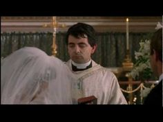 Rowan Atkinson plays the bumbling and tongue-tied priest in Four Weddings and a Funeral (1994), directed by Richard Curtis, which demonstrated his ability to steal a scene with just a few nervous mispronunciations.
