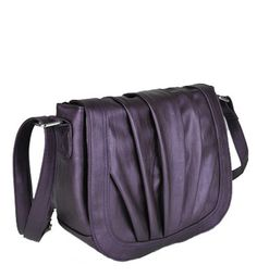 I realize this is meant to be a camera bag, but it really could be the perfect purse for me.  Not sure on the color choices, though.