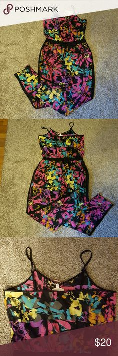Flirty and colorful tuxedo pant romper Beautifully patterned romper with tuxedo pant legs and draw string middle. Size large. New w/tags Pants Jumpsuits & Rompers