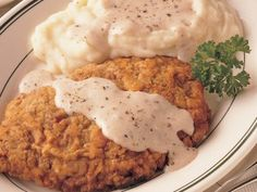 Chicken Fried Steak with Mashed Potatoes and Peppered Cream Gravy