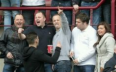 Leigh Griffiths among the Hibs faithful before a clash with Hearts at Tynecastle. (2014) Photo: Action Images