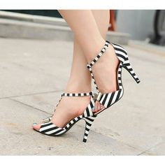 Black and white colour heels.