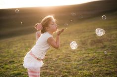 blowing wishes... girl with bubbles