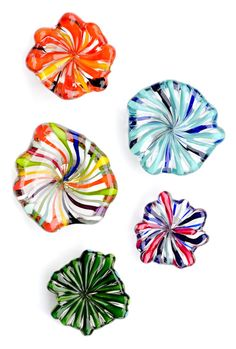 Lovin' these color burst blown-glass magnets.