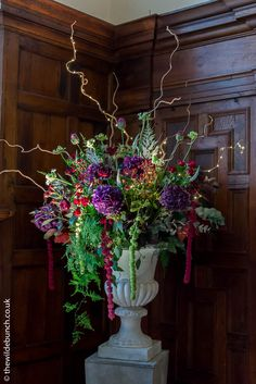 A classic Wilde Bunch Plinth & Urn at North Cadbury Court featuring deep autumnal colours Family Holiday, Holiday Decor, Country House Wedding Venues, London Bride, Reception Rooms, Autumnal, Urn, Colorful Flowers, Wedding Events