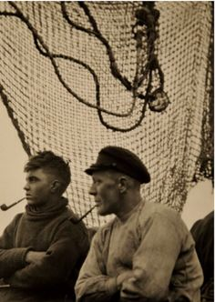 Men aboard a ship. Often times, sailors wouldn't see their families for months at a time out on the high seas