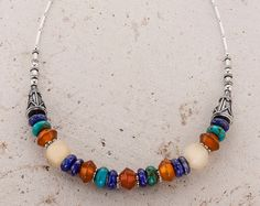 Multi gemstone necklace Sterling Silver Ethnic Necklace by GefenJewelry. This multi gemstone necklace is crafted in sterling silver and features Turquoise, Lapis lazuli, Carnelian and yellow quartz stones in a flexible single line design.