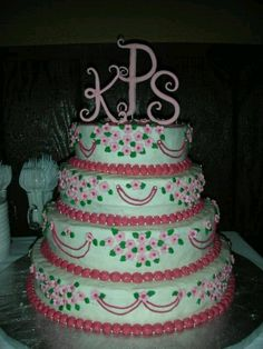 My very first Wedding Cake... some very good family friends were getting jipped on their daughters cake so I offered to make it instead. This is what she got, and I made the topper myself... :)