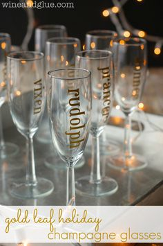 Gold Leaf Holiday Champagne Glasses | www.wineandglue.com | Why use wine charms when you can just pick a reindeer name?  Classy, fun, and super easy to make!