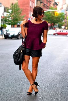 Peplum top with black leather shorts