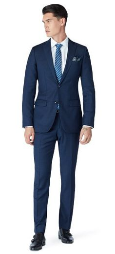 Nearly imperceptible to the eye, this suit's plaid patterning serves to emphasize its unique texture through an interplay of extremely slight changes in weave and shade. Throw in a touch of silk, and you've got a fabric that's truly unique.
