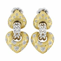 Pair of Two-Color Gold and Diamond Pendant-Earclips, Giovani   18 kt. yellow and white gold, topped by fancy-shaped gold panels studded with round diamonds, suspending puffed heart-shaped gold panels applied with diamond-set white gold pear-shaped plaques, joined by two rows of braided white gold, totaling 74 round diamonds approximately 1.25 cts., signed Giovani, Italy.