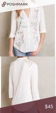 """Anthropologie Kalei Top by TINY Embroidered Floral Brand new with a very small hole near the tag in the next. See pics. Rest of the top is perfect! Extra button still attached to brand label tag. Rayon, Polyester, Spandex. Button Front. Hand Wash. Imported. Bust is 39"""" Anthropologie Tops Button Down Shirts"""