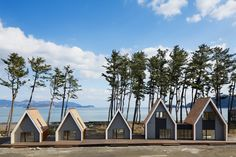 after being destroyed from the earthquake, zai shirakawa architects have developed a pre-fabricated scheme that hosts programs such as a cafe and surf shop.