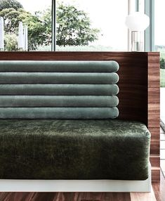 Blue and green velvet bench seat in a hospitality setting